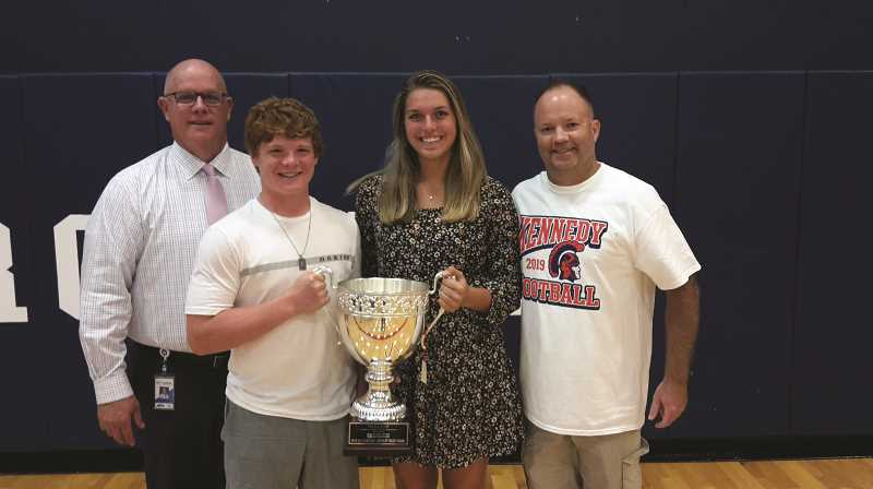 COURTESY PHOTO: JAMES DAY/OUR TOWN - Kennedy High School senior athletes Bruce Beyer and Sophia Carley hold up the 2018-19 OSAA Cup, bracketed by JFK Principal Dale Pedersen (left) and Athletic Director Kevin Moffatt.