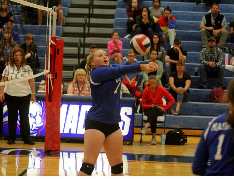 STEELE HAUGEN - Senior Aspen Holcomb makes a dig during the Lady Buffs' 3-0 home loss to Crook County Sept. 10.