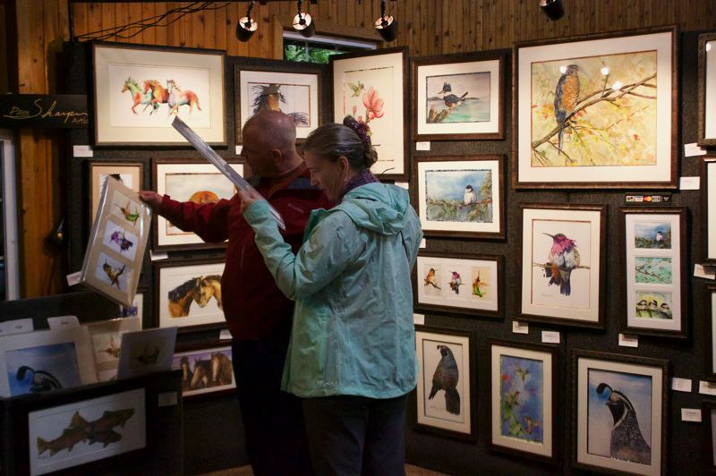 PMG FILE PHOTO - Visitors check out some of the creations on display at the 2018 Festival of the Arts held at Glenn Otto Community Park in Troutdale.