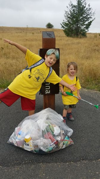 COURTESY PHOTO: GODS WORK, OUR HANDS - Two of the smallest volunteers helped pick up trash at Powell Butte.