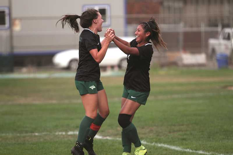 PMG FILE PHOTO: PHIL HAWKINS - North Marion's Mya Hammack and Dominique Huapeo celebrate after hooking up for a goal earlier in the season against Woodburn. The pair accounted for seven goals and three assists in the Huskies 12-1 win over Junction City on Sept. 10.