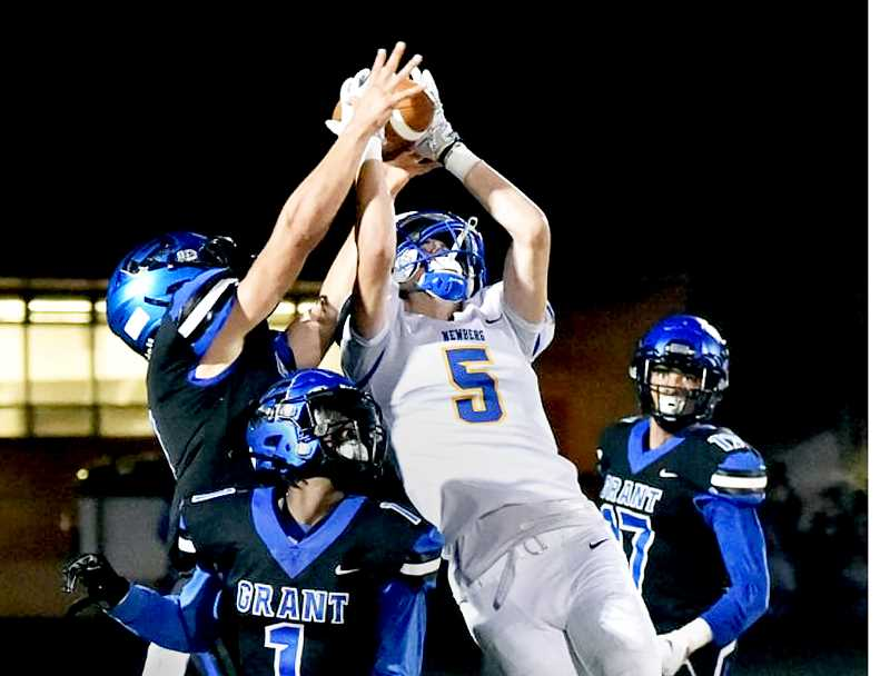 PHOTO COURTESY OF DEAN TAKAHASHI  - Junior wide receiver Owen Hawley hauls in a pass during the Tigers' 29-28 loss to the Grant Generals on Friday.