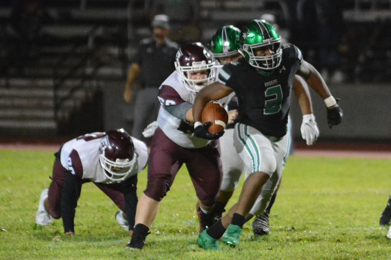 PMG PHOTO: DAVID BALL - Reynolds QB Dominique Miller turns upfield for a big gain during the third quarter of the Raiders 64-0 home win over Franklin on Friday.