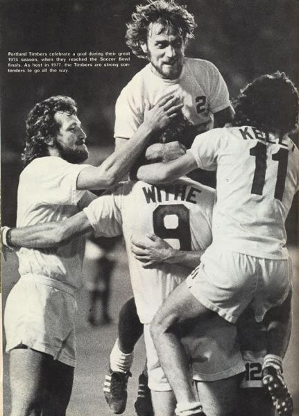COURTESY PHOTO: OREGON SPORTS HALL OF FAME - Defender Ray Martin jumps on forward Peter Withe as winger Jimmy Kelly (right) and defender Graham Day join the celebration during a 1975 Portland Timbers season.