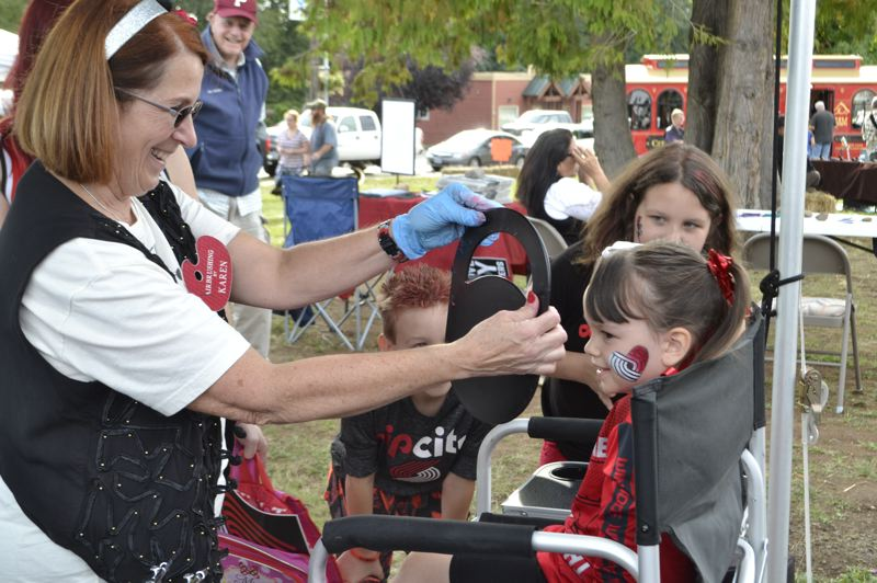 PMG PHOTO: BRITTANY ALLEN - People of varying ages sported their Blazers love with glittering face paint at the Rip City Rally.