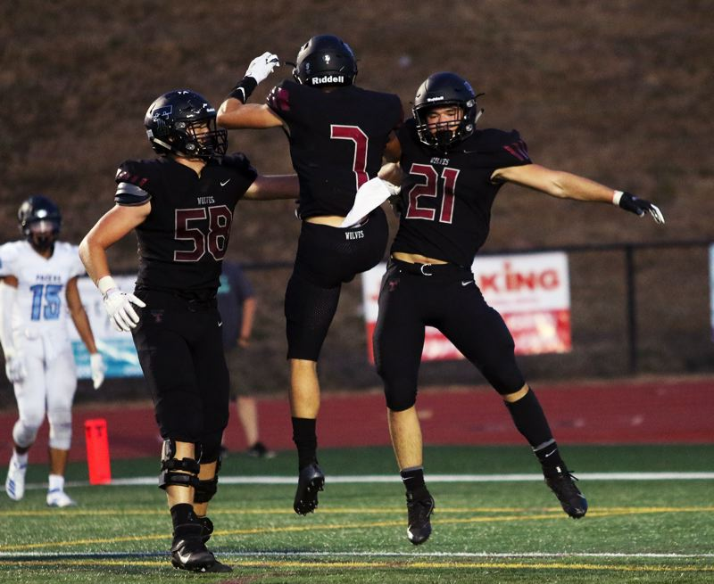 PMG PHOTO: MILES VANCE - The Tualatin football team had a lot to celebrate over the past week as the Timberwolves won their second straight game and moved up to second in the latest Class 6A statewide coaches poll.