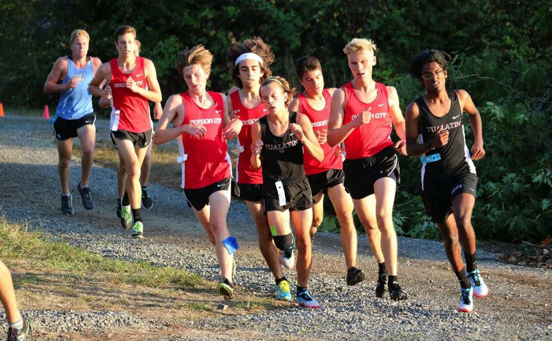 PMG PHOTO: JIM BESEDA - Oregon City cross country runners (red jerseys, left to right) Jonathan Schaffer, Max Reed, Daniel Polanco, Johnny Brito, and Grant Pauli ran as a pack through the first two and one-quarter miles of Wednesdays Three Rivers League preview meet at Clackamas Community College.