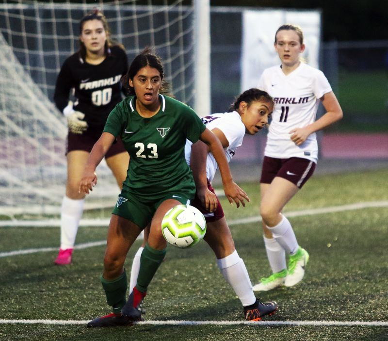 PMG PHOTO: DAN BROOD - Tigard High School senoir Anette Hernandez Bran (23) looks to get to the ball during the Tigers' 4-0 win over Franklin on Tuesday.