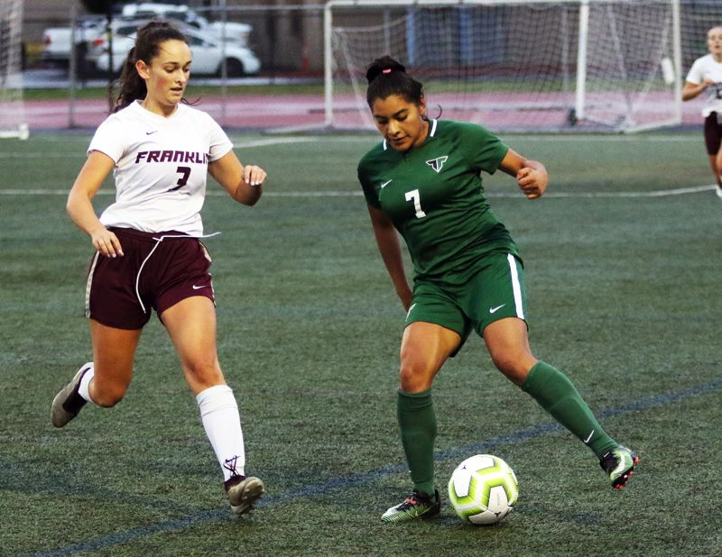 PMG PHOTO: DAN BROOD - Tigard High School senior Steffani Rodriguez (right) controls the ball against Franklin senior Sylvia Goldrich-Middaugh during the Tigers' 4-0 win on Tuesday.