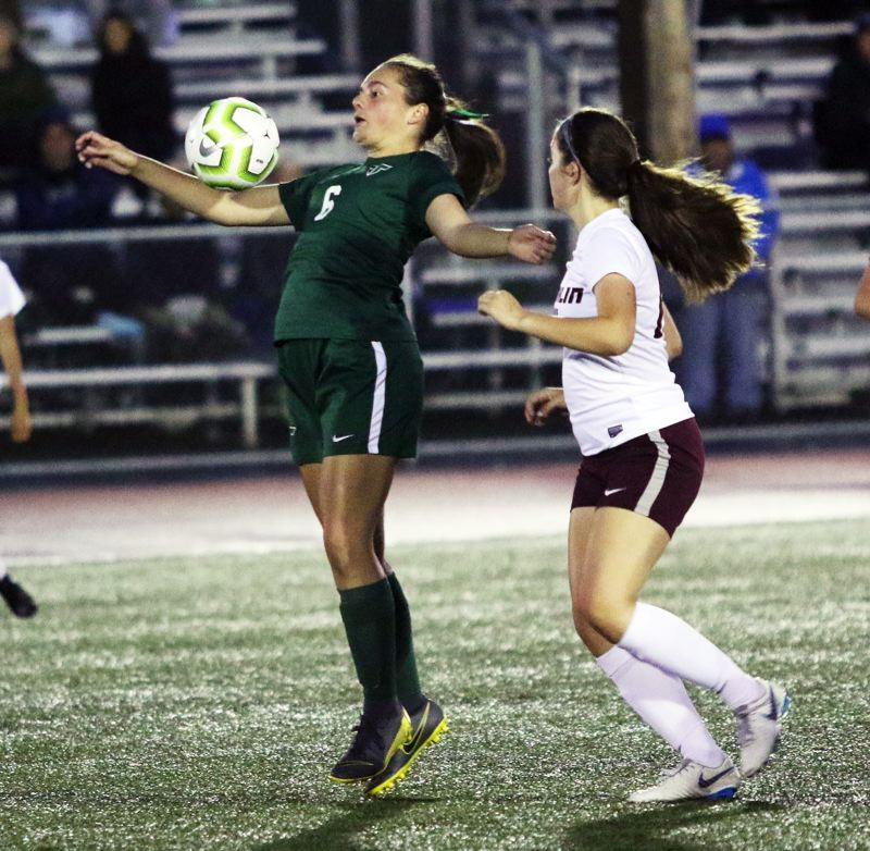 PMG PHOTO: DAN BROOD - Tigard High School junior Caitlyn Cannan (left) controls the ball during the Tigers' 4-0 win over Franklin on Tuesday.