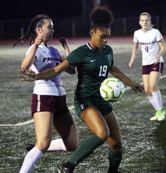 PMG PHOTO: DAN BROOD - Tigard High School junior Ajae Holdman (19) controls the ball during the Tigers' 4-0 win over Franklin on Tuesday.