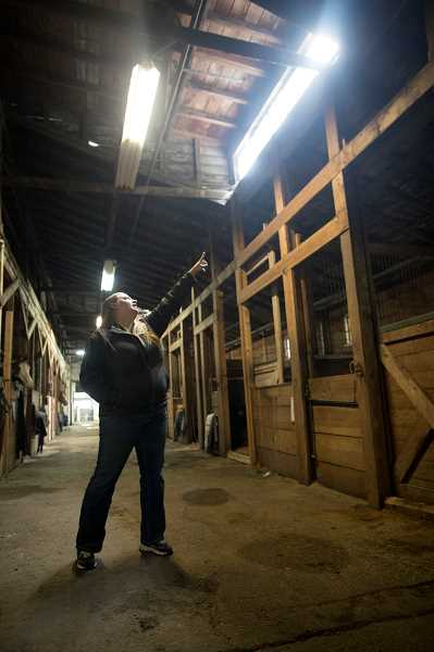PMG PHOTOS: JAIME VALDEZ - Barn Director Taryn McAllister shows where rainwater is leaking from the roof in the stables at Lake Oswego Hunt Club.