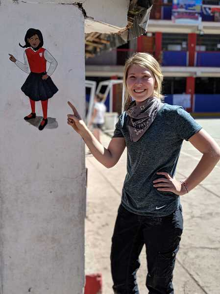 COURTESY PHOTO - Nicole Konicke with one of the small murals she created at the school in Ollantaytambo.