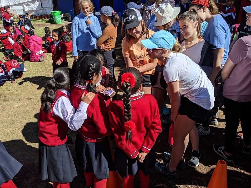 COURTESY PHOTO - Lakeridge Spanish students with students from the school they worked at in Ollantaytambo.