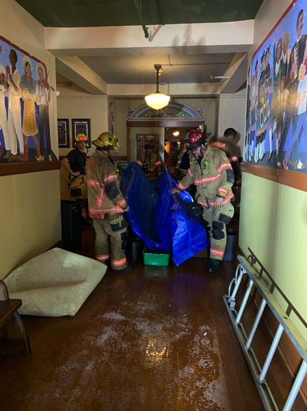 COURTESY PHOTO: GRESHAM FIRE DEPARTMENT - Gresham firefighters try to get the water out of the historic Edgefield hotel.