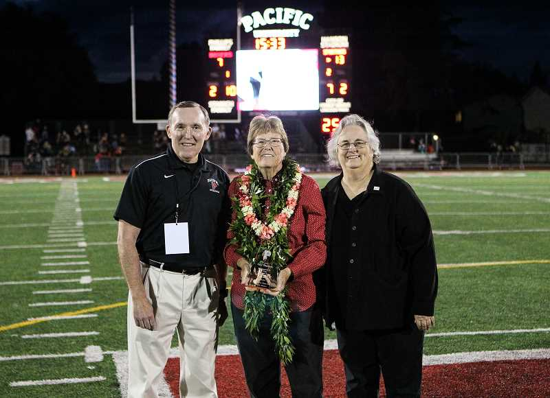COURTESY PHOTO: GARY BREEDLOVE - Ken Schumann (left), Judy Sherman (center) and Pacific University President Lesley Hallick (right) pose for a photo during halftime of the Boxers' game last year versus Dubuque.