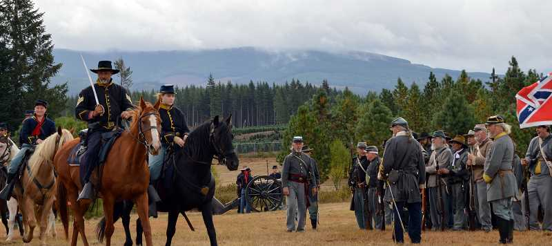 PMG FILE PHOTO: CINDY FAMA - Pictured are the confederate and union soldiers at last year's reenactment.
