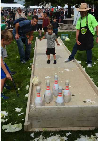 PMG PHOTO: STEVE BRANDON - Numerous events and activities were lined for children to enjoy during the 30-year anniversary of the Scappoose Sauerkraut Festival, including a festival staple: cabbage bowling.