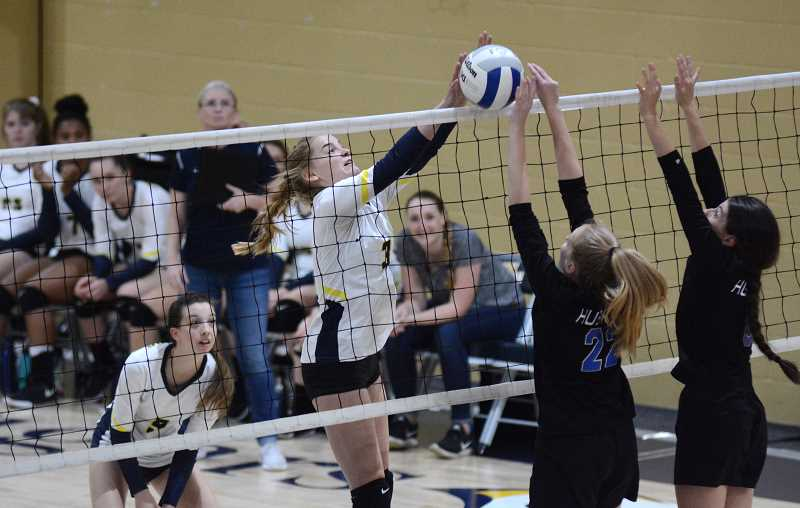 PMG PHOTO: DEREK WILEY - Country Christian sophomore Elizabeth Grandle blocks the ball at the net Thursday against Open Door Christian Academy.