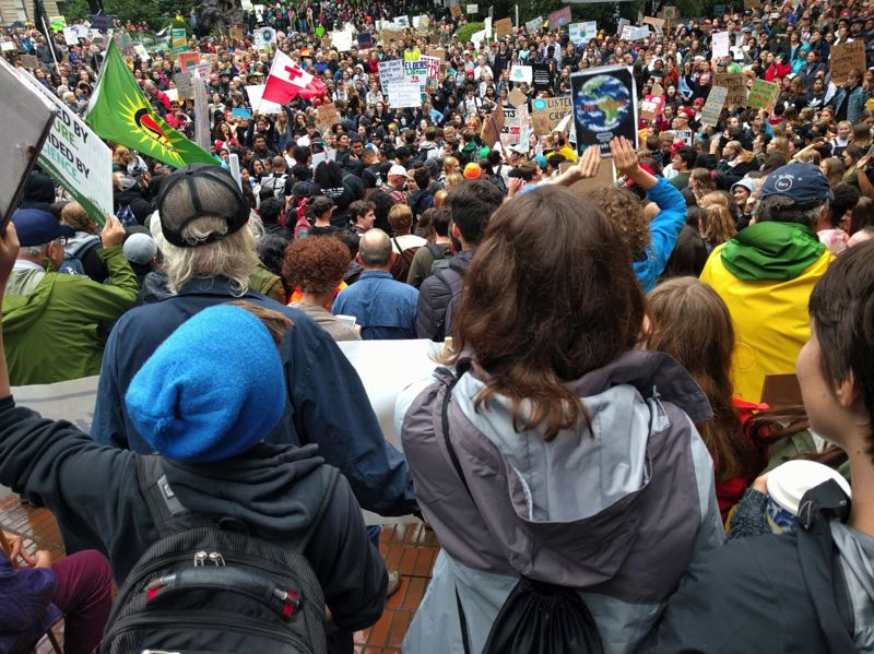 PMG PHOTO: JIM REDDEN - Large crowds fill Terry Schrunk Plaza in downtown Portland as students from all over — and adults who agree with them — protest inaction against climate change.