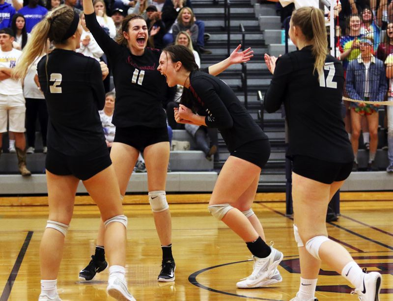 PMG PHOTO: DAN BROOD - Sherwood High School players (from left) Allison Fiarito, Julia Leitzinger, Josie Wilson and Evan Parent Korsness celebrate during the fourth set of the Lady Bowmen's win over Newberg.