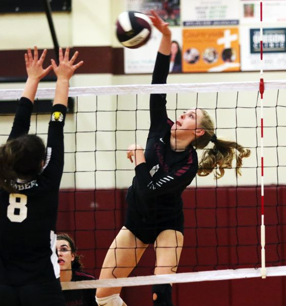 PMG PHOTO: DAN BROOD - Sherwood High School senior Alli Douglass (right) goes up for a kill during the Lady Bowmen's Pacific Conferrence victory over Newberg.