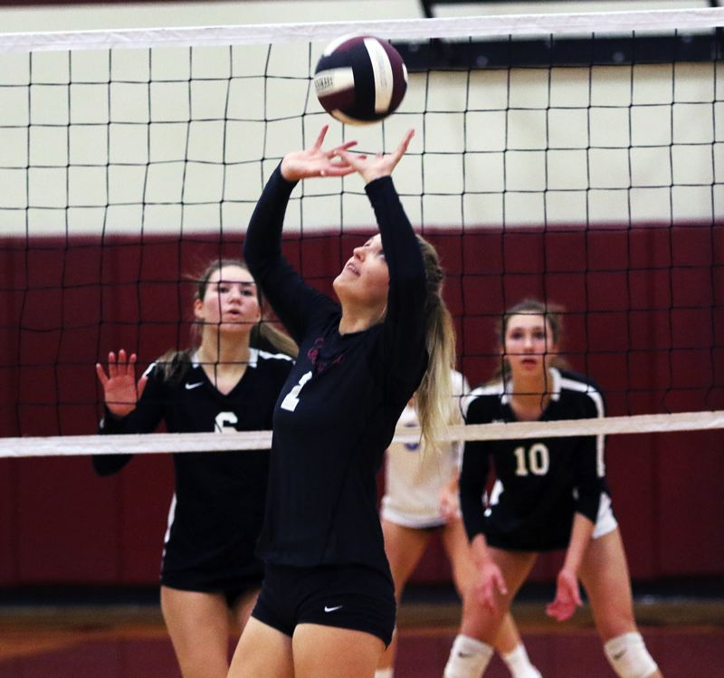 PMG PHOTO: DAN BROOD - Sherwood High School senior Allison Fiarito sets the ball during the Lady Bowmen's 3-1 victory over Newberg in Wednesday's Pacific Conference match.