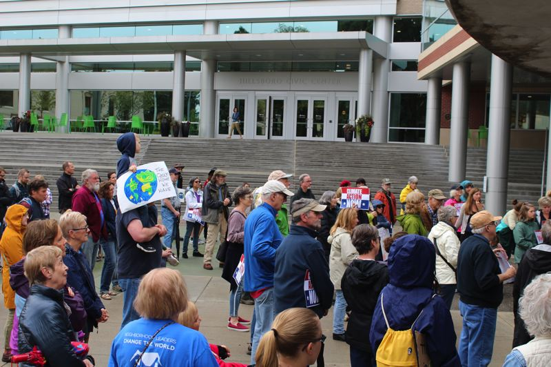 PMG PHOTO: MARK MILLER - Dozens rally outside the Hillsboro Civic Center on Friday morning, Sept. 20, in support of climate action.