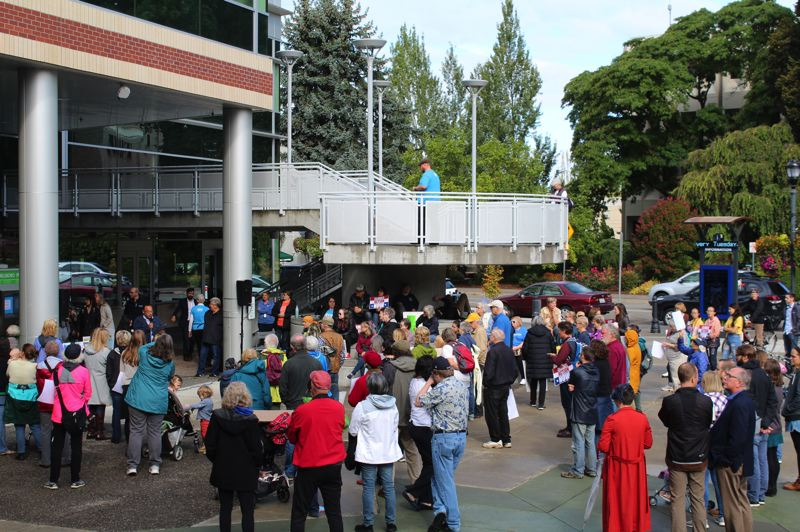 PMG PHOTO: MARK MILLER - A crowd listens to one of the speakers at the Friday, Sept. 20, Climate Strike rally in downtown Hillsboro.