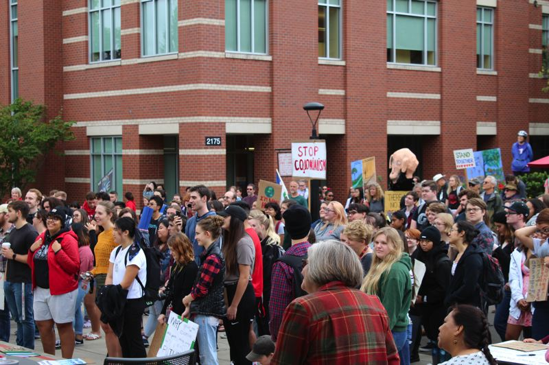 PMG PHOTO: MARK MILLER - A climate change rally on the Forest Grove campus of Pacific University drew a crowd of hundreds on Friday, Sept. 20.