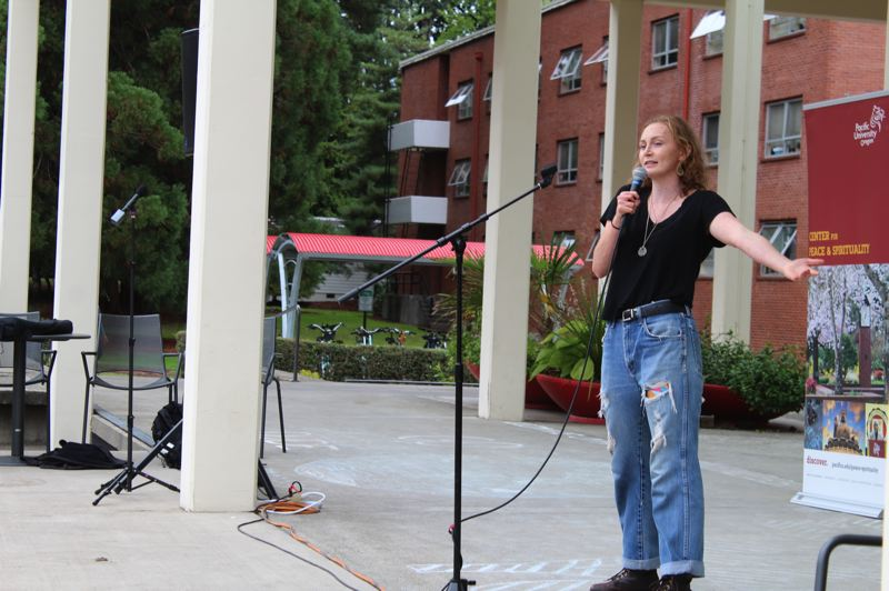 PMG PHOTO: MARK MILLER - Karsen Buck, a student at Pacific University, urges attendees at a Climate Strike rally on campus Friday, Sept. 20, to model sustainable living in their own lives.