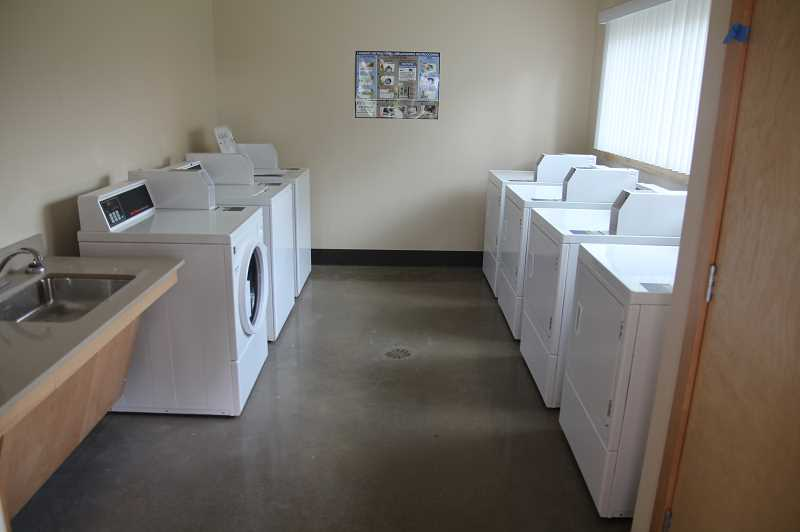 PMG PHOTO: JUSTIN MUCH - Amenities at the new Colonia Unidad apartments, a Farmworker Housing Development Corporation complex in Woodburn, include laundry facilities, a community room and a boot-wash area for farm workers to clean up after a hard day in the field.