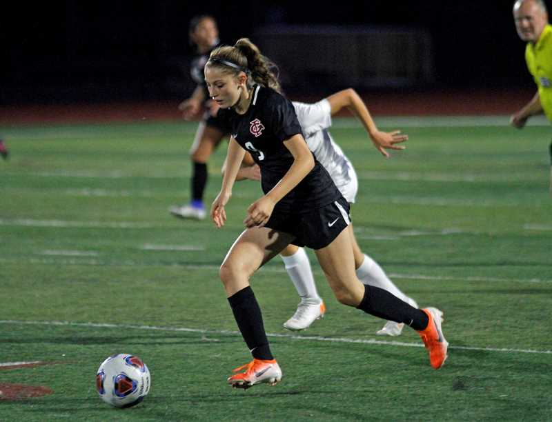 PMG PHOTO: WADE EVANSON - Forest Grove freshman Sophia Broberg dribbles up the field during the Vikings' game against the Beavers Thursday, Sept. 19, at Forest Grove High School.