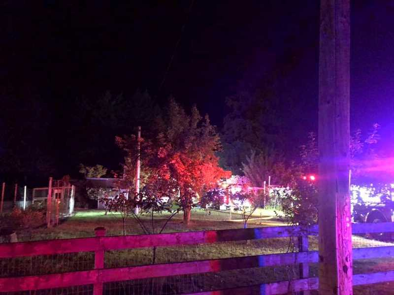 COURTESY PHOTO: MOLALLA FIRE - The fire at a two-story house in Colton on Sept. 19 lit up the night. Five fire stations assisted, luckily no one was injured and the fire was contained to the roof and attic.