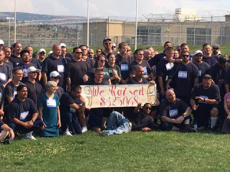 SUBMITTED PHOTO - DRCI inmates raised $3,200 in support of suicide prevention during the Out of the Darkness event earlier this month. Inmates walked the grounds of the Madras facility.