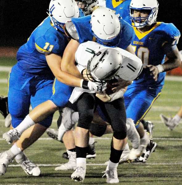 GRAPHIC PHOTO: GARY ALLEN - The Newberg defense forced four Summit turnovers in just the first half of its dismantling of the Storm at home Friday evening.