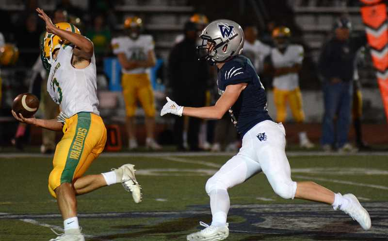 PMG PHOTO: DEREK WILEY - Wilsonville junior Colby Guenther chases down Cleveland quarterback Logan Geiszler for a sack in the first half of the Wildcats 66-7 win Friday.