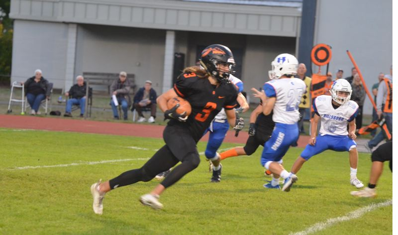 COURTESY PHOTO: JOHN BREWINGTON - Drake Kramer of Scappoose High takes off with the ball during a Friday night home game against Hillsboro.