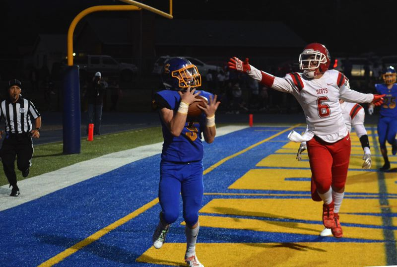 TIMES PHOTO: MATT SINGLEDECKER - Aloha senior wide receiver Payton Volk pulls in a big touchdown against David Douglas.