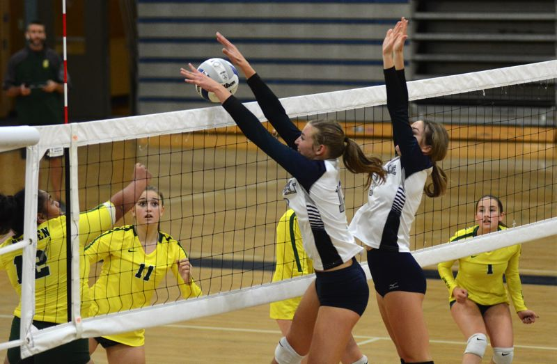 PMG PHOTO: DEREK WILEY - Wilsonville senior Lindsey Hartford blocks a shot at the net Tuesday against Putnam.