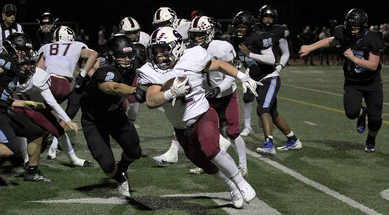 PMG PHOTO: MILES VANCE - Sherwood's Lucas Voss races around the left edge for a 15-yard touchdown late in the first half that helped his team beat Lakeridge 50-13 at Lakeridge High School on Friday, Sept. 20.