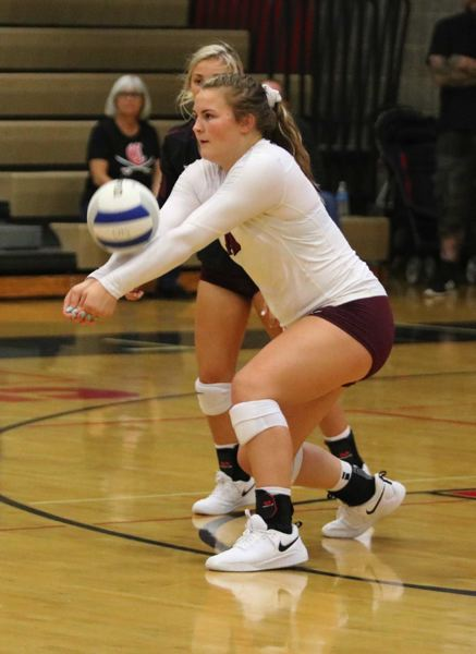 PMG PHOTO: JIM BESEDA - Sandys Sydney Brewster bumps a ball into the front row during the Pioneers loss at Clackamas last week.
