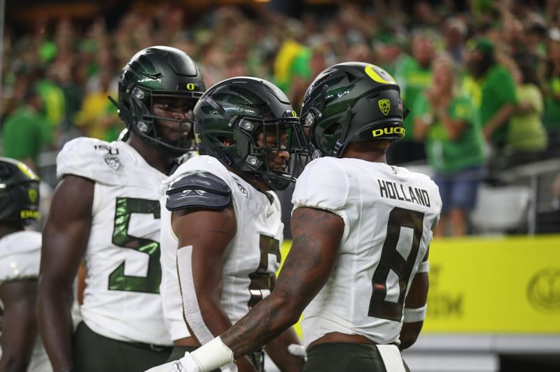 COURTESY PHOTO: SERENA MORONES - University of Oregon players (from left) Bryson Young, outside linebacker, Deommodore Lenoir, cornerback, and Jevon Holland, safety, have been mainstays on a lockdown Ducks defense this season.