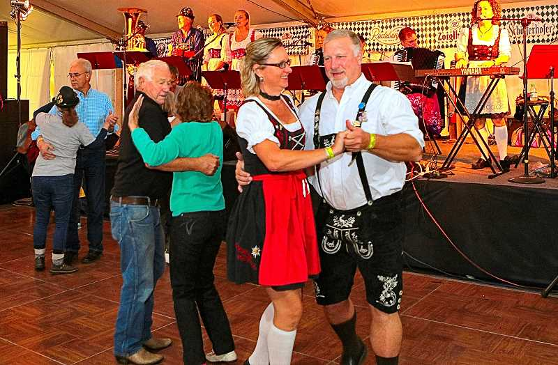 DAVID F. ASHTON - Dressed for dancing, William and Amy Luke (foreground) told THE BEE they came all the way from Spokane to enjoy this Oktoberfest in Sellwood.