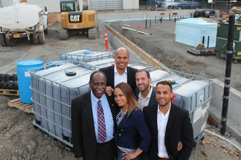 COURTESY: COLAS CONSTRUCTION - Colas Construction is BDIs Minority Business Firm of the Year. The companys management team includes (first row, l-r) founder Hermann Colas Jr.; Aneshka Colas-Dickson, vice-president and CFO; Alex Colas, who runs the special projects division; and (back row, l-r)  Andrew Colas, president and CEO, and Marc-Daniel Domond, executive project manager.