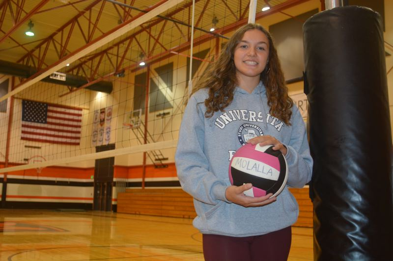 PMG PHOTO: DEREK WILEY - Paula Romero, an exchange student from Spain, has made an immediate impact on the Molalla volleyball team.