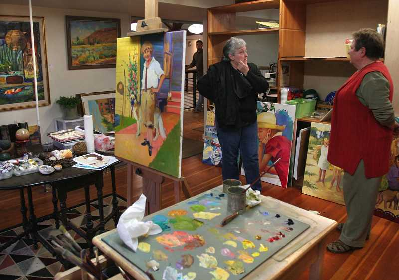 FILE PHOTO - JoAnn Wellner, left, talks with artist Fran Richards in Richards studio located in the Sequoia Gallery and Studios in Hillsboro during the First Tuesday Art Walk.