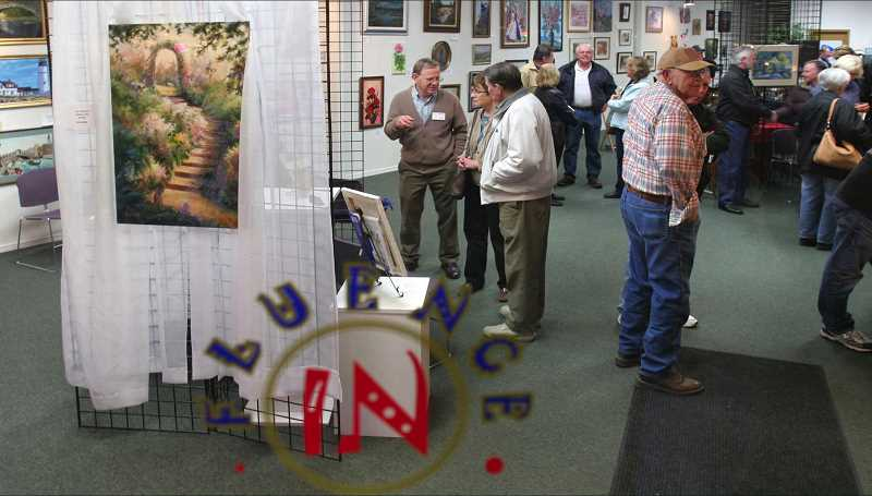 FILE PHOTO - Art lovers gather at Influence Gallery during Hillsboros First Tuesdays Art Walk.