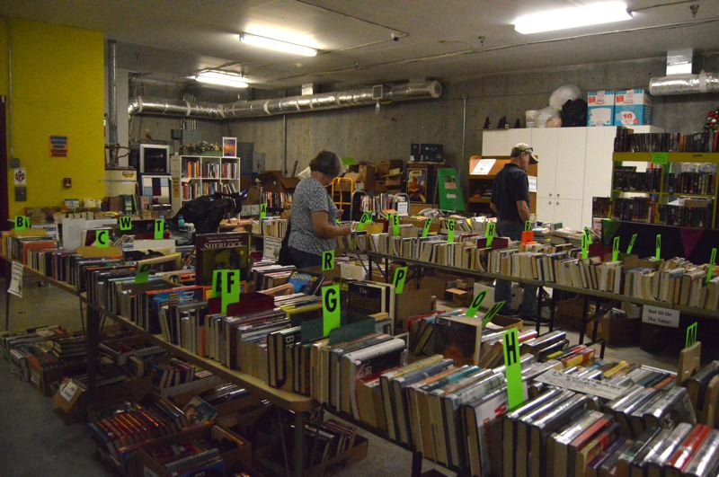 PMG PHOTO: NICOLE THILL-PACHECO - The Friends of the Scappoose Public Library hosted a book sale during the Sauerkraut Festival and invited people to purchase books, DVDs games and more for low prices.