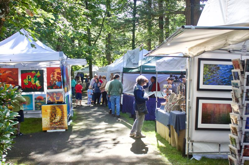 PMG PHOTO: CHRISTOPHER KEIZUR - Troutdales fifth annual Fall Festival of the Arts brought 60 local artisans across a variety of mediums into Glenn Otto Community Park during the weekend.